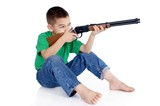 boy aiming a gun, isolated on white