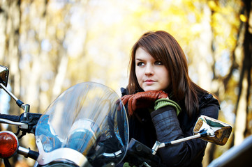 The girl the brunette on a motorcycle