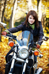 The girl the brunette sits on a motorcycle
