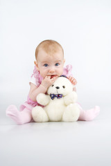 Beautiful little girl with cuddle-bear.