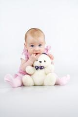 Beautiful little girl with cuddle-bear.