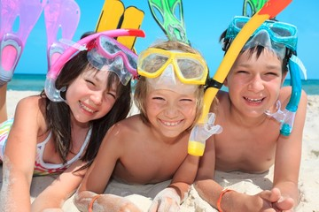 Three kids with snorkels