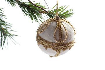 Isolated white ball hanging on the Christmas tree