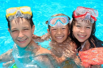 Three happy children in pool