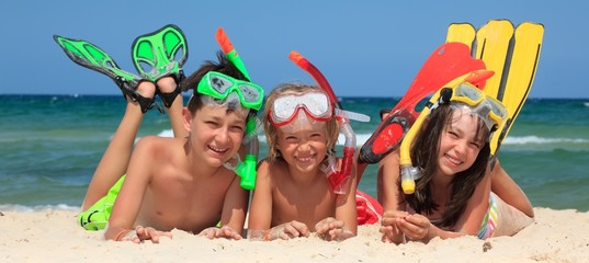 Three snorkeling kids