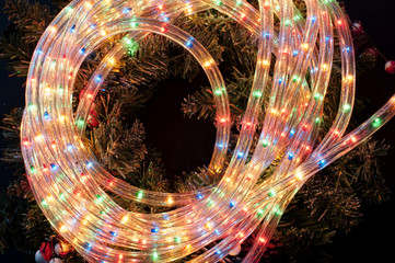 Decorative multicoloured twinkling tube rope lights switched on