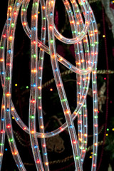 Decorative coloured twinkling tube rope lights switched on