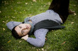 Young man lying in a park