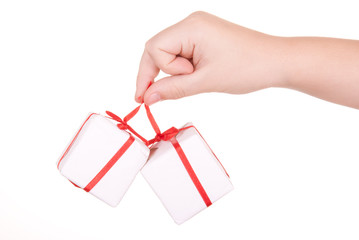 Hand holds boxes with gifts