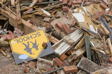 School Sign in Rubble