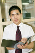 young asian businessman with folder