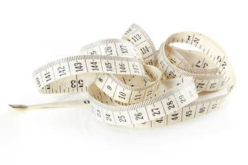 Curled white measuring tape