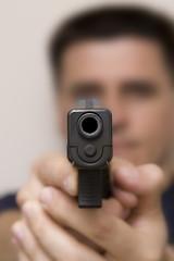 Man pointing a gun.