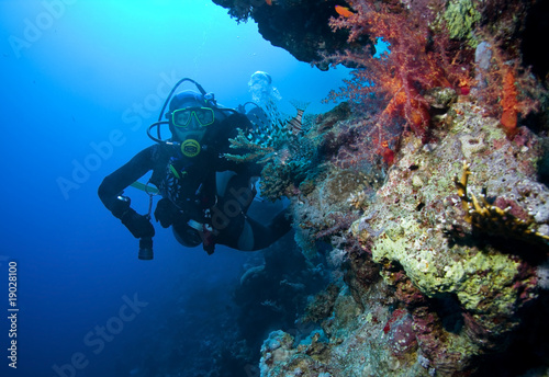 Woman Scuba Diver and Lionfish