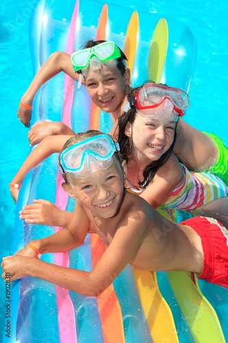 Children on float in pool