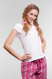 young woman in pajamas poster