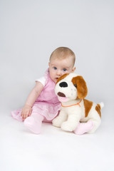 Little girl with plushy doggy.