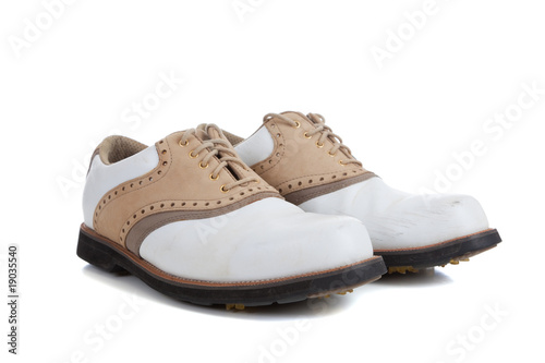 Pair of golf shoes on a white background