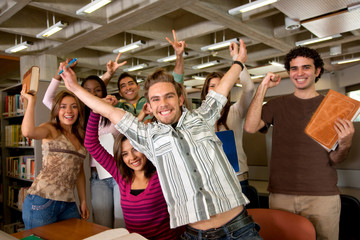 Happy students at the library