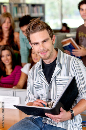 Happy student with a notebook