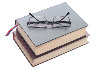 two books with glasses isolated on white background.