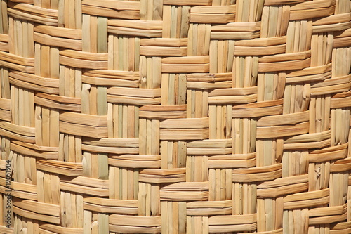 Photo: Floor mat made from woven reeds background © Vladimir Melnik #