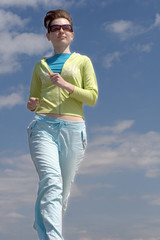 Attractive sportswoman running outdoors