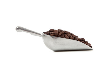 A silver scoop with coffee beans on white