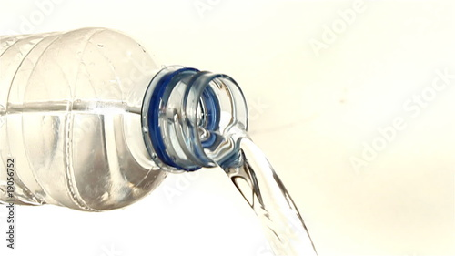 Water pouring out of a plastic bottle