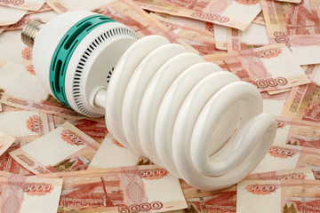 Power saving up bulb against the Russian money