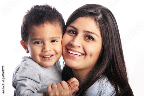 Mother & son close-up cuddling portrait