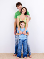 young happy smiling family looking at camera