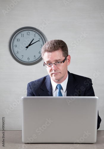 Bored man on laptop computer