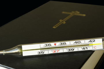 Thermometer and the Bible.
