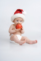 Infant with apple.