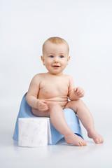 Little girl on potty.