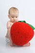 Child with plushy strawberry.