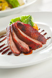 Oven crisp duck breast marinated in a Peking duck style sauce on poster