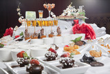 Asian Fusion appetizers and desserts on table poster