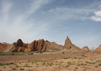 Road across Red rocks in the desert.