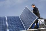 Workman assembling solar poster