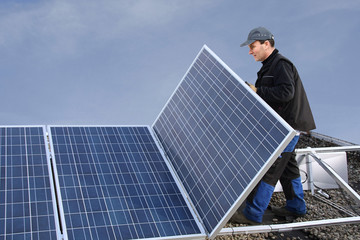 Workman assembling solar