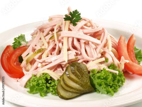 Leinwanddruck Bild Wurstsalat mit Käse