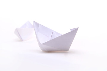 Three paper ships isolated on white.