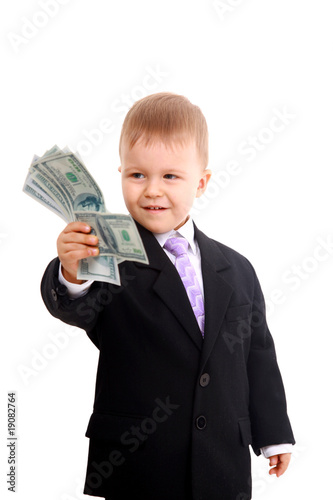 Cute little boy holds a fan of banknotes.