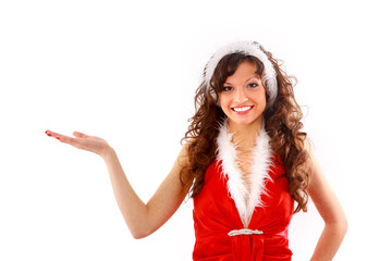 Woman in Santa Claus dress is looking on her hand.