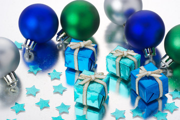 Colorful gifts, christmas balls and stars