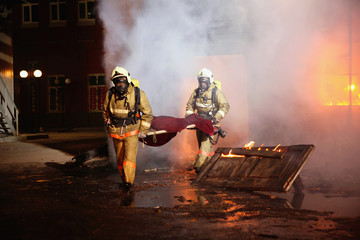 Firefighters carrying an accident victim