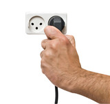 Hand inserting power plug to socket poster