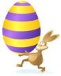 rennender Cartoon Osterhase mit Riesenei